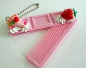 Chocolate shaped comb decorated by delicious looking clay food - Block strawberry chocolate