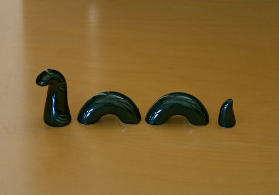 Vintage Mid Century Loch Ness Monster Figurine High Glaze 4 Pc