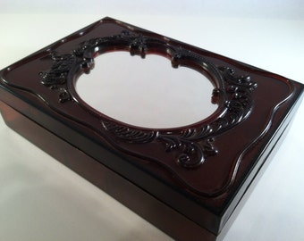 Vintage mirrored frame lidded box with jewelry inserts with Cupid details amber brown plastic