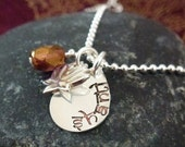 Hand stamped sterling teardrop charm with lotus and glass bead