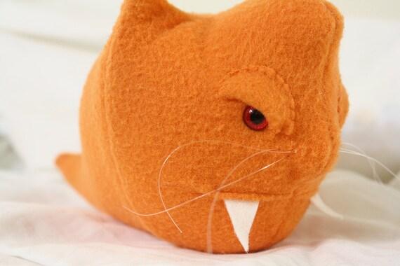 slithering demon kitty monster in orange fleece
