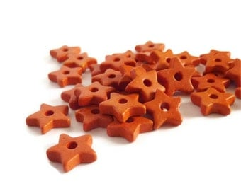 Orange Ceramic Star Beads - 19 pcs C 10 072