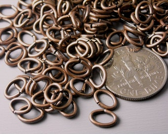 JUMPRING-CPPR-OV-7MM - 22 gauge 7mm Antique Copper Oval Open Jump Rings - 50 pcs
