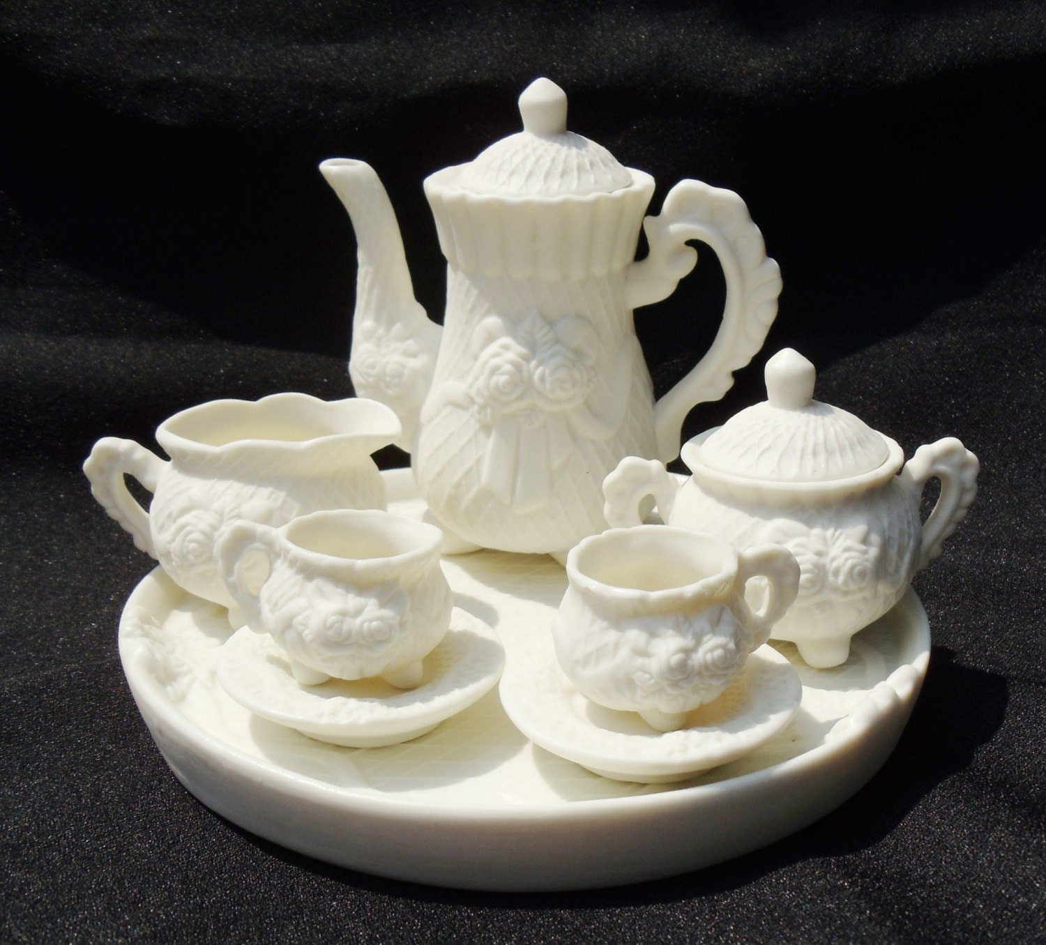 vintage miniature tea set with rose design
