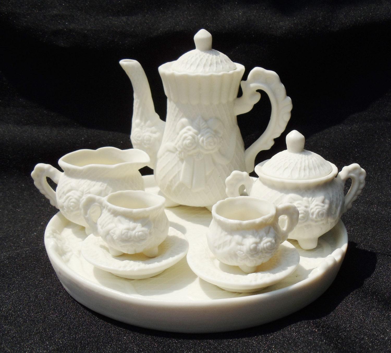 vintage miniature tea set with rose design