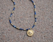 Gold-plated brass & lapis necklace with Lotus symbol pendant