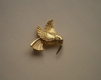 Classic Gold Tone Hummingbird Bird with Ruby Eye Pin Brooch presented by