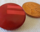 """1 vintage 'ox blood red' buttons, with carved top, approx 1"""" in across. Celluloid style shank. WAMVI13.1-12.4-30.4"""