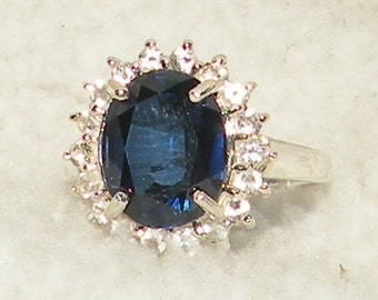 Blue Sapphire Ring with White Topaz Accents Ring