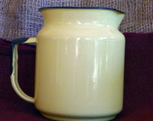 Retro enamelware pitcher, pale yellow with dark blue edges