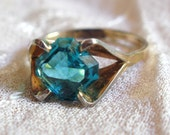 Gold Tone Engagement Ring with Blue Setting - Size 6