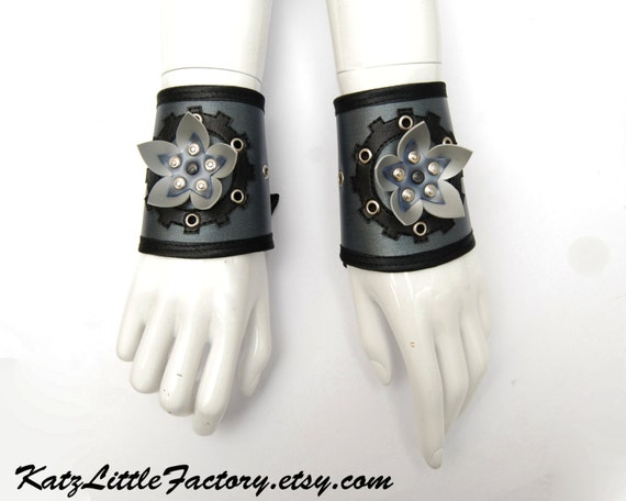 Cyberpunk inspired Silver Chameleon Cuffs with PVC Cyber Flowers black gears and corset lacing