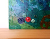 Order for Erin Siemer: green acrylic mixed media stretched canvas with tissue paper and buttons