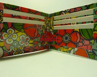 hand made duct tape wallet with flowers all over it