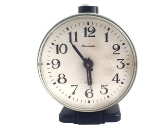 CLOCK wind up alarm clock, use for home decor.