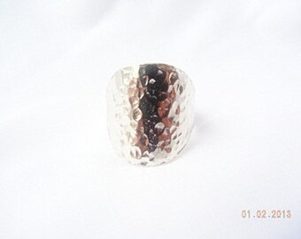 Beautiful hammered silver ring. Face of Ring is a Large Round to Reveal the Quality of the Silver. Shine.