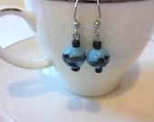 Vintage sky blue glass bead earrings with black details