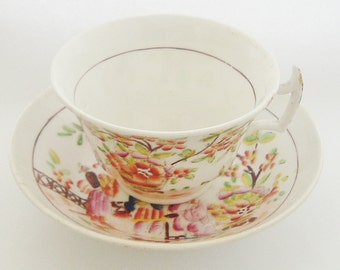 Antique English porcelain cup and saucer oriental style famille rose