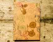Handbound TRAVEL original design hardcover journal/sketchbook with recycled blank white pages and aqua Coptic stitching.