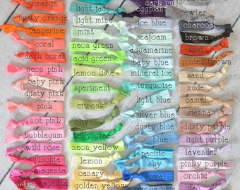 5 free w/ purchase of 20. no crease elastic hair ties. set of 10. you pick colors. 92 colors to choose from.