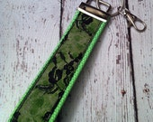 Black lace over lime green key fob wristlet on lime green cotton webbing with swivel lobster clasp