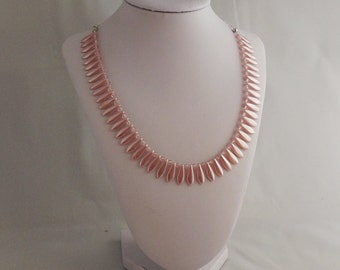 Soft pink pearlescent collar necklace