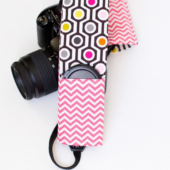 DSLR camera strap cover with lens cap pocket.  Lattice with pink chevron.