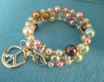 Memory wire jewelry pastel beaded bracelet with two peace sign charms