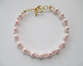 Handmade Jewelry beaded pink crystal and pearl bracelet with gold tone heart toggle clasp
