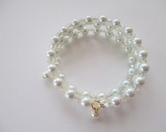 Handmade memory wire bracelet white pearl beads and crystal glass beads.