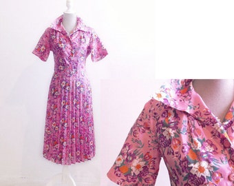 Pink floral dress with full pleated skirt 1960