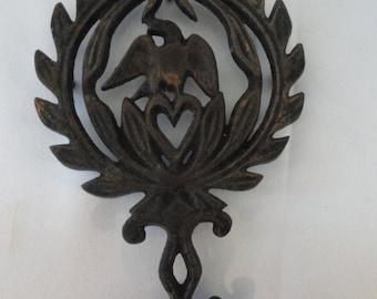 Trivet, hotplate, cast metal, eagle and leaves,