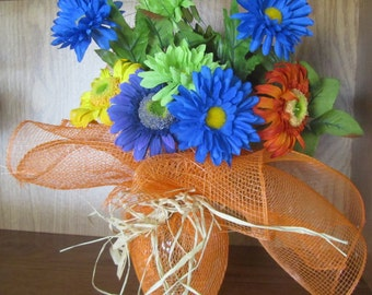 Vase Wrapped in Orange Mesh filled with Gerbera and Spider Daisies