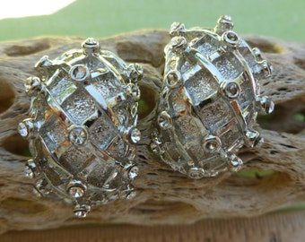 Spiked silver and white Rhinestone clip earrings.