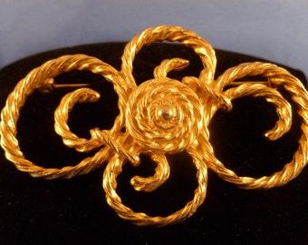 Gold Swirl Brooch.
