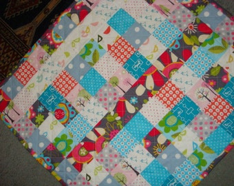 Handmade with love...lovely modern baby quilt for a girl.