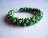 Beaded hand crochet bracelet out of green beads