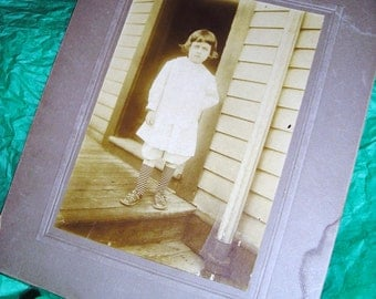 Vintage Bloomer Girl Photo ......Striped Socks......Striped Dress.....Back Porch ....Sepia Photo