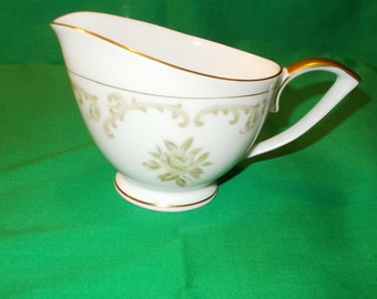 One (1), Porcelain, 8 oz. Creamer, from Mikasa, in the Sceptre 8277 Pattern.