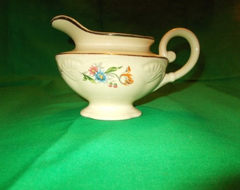 One (1),  8 oz Creamer, from Homer Laughlin, in a Unknown Pattern.