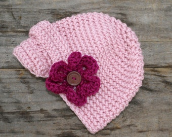 Crochet hat with bill and flower