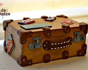 Personalized Music Box. Hand cranked mechanism. Old suitcase with travel stickers.