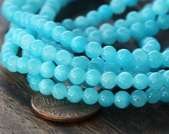 Mountain Jade Beads, Light Blue, 4mm Round - 16 Inch Strand - eMJR-B05-4