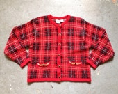 vintage 1980s cardigan sweater in classic style. red plaid with gold chain accents. retro clothing.