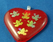Fused glass heart pendant with dichroic frogs