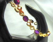 AVON Bracelet X's and O's Purple and Gold