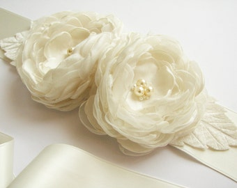 Bridal sash with two ivory handmade flowers and leaves