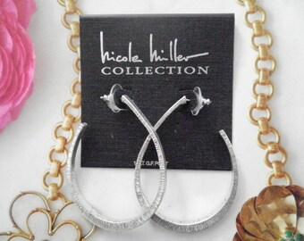 1 Pr. Nicole Miller Silverplated Earrings