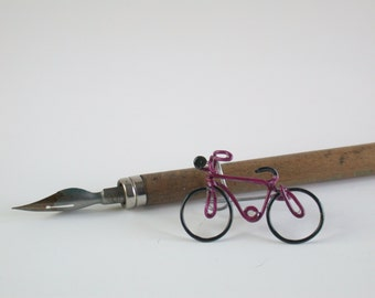 Bicycle brooch, steel wire, hand painted.