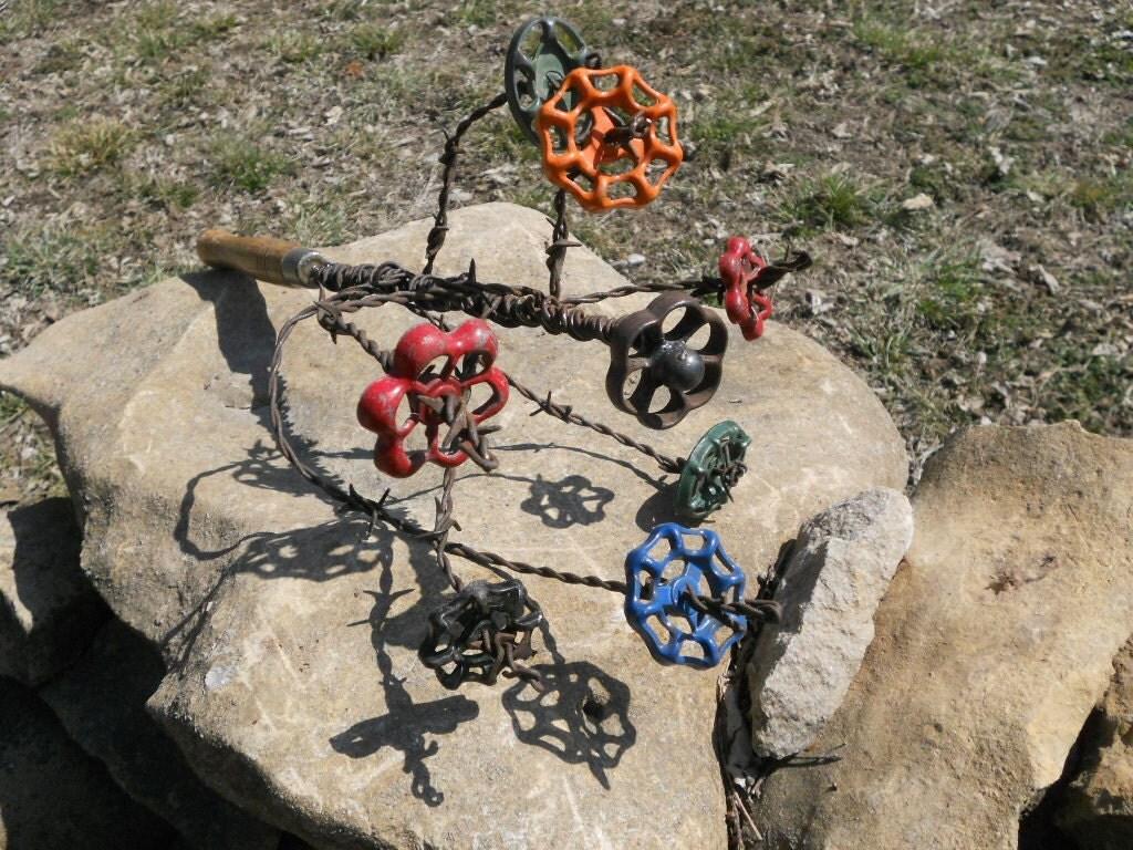 Faucet flower antique barb wire metal sculpture cactus